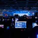 dark event venue filled with gaming personal computers and gamers